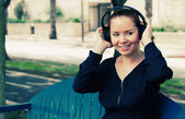 Woman with Headphones Outdoors — Stockfoto