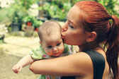 Mother and baby outdoors — Stock Photo