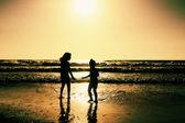 Children playing on the beach  — Stock Photo