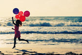 Beautiful woman with colorful balloons — Stock Photo