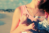 Mother and baby at beach — Stock Photo