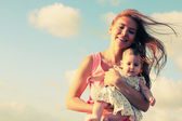 Happy loving mother with her baby — Stock Photo