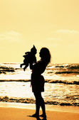 Silhouette of mother and baby — Stock Photo