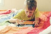 Cute boy using laptop — Stockfoto