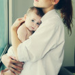 Young mother with her 6 month old baby — Stock Photo