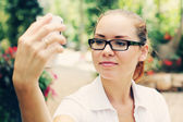 Young woman taking photos with a smartphone — Stok fotoğraf