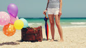 Woman with colorful balloons on seaside — Stok fotoğraf