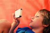 Cute boy with mobile phone — Stock Photo