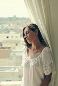 Woman near the window — Stock Photo