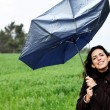 Girl with umbrella. Photo in old color image style. — Stock Photo #9833916