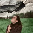 Girl with umbrella. Photo in old color image style. — Stock Photo #9834262