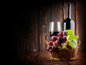 Wine on the old wooden background — Stock Photo