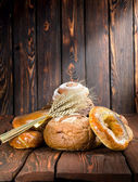 Bread on a old wooden boards — Stock Photo