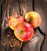 Red apples on the wooden table — Stock Photo
