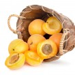 Ripe apricots in a wooden basket — Stock Photo