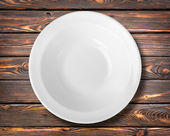 White plate on a table — Stock Photo