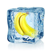 Ice cube and banana — Stock Photo