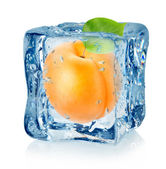 Ice cube and apricot isolated — Stock Photo