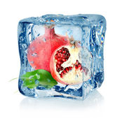 Ice cube and pomegranate — Stock Photo