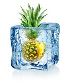 Ice cube and pineapple — Stock Photo