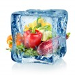 Ice cube and vegetables — Stock Photo