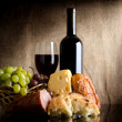 Wine bottle and food — Stock Photo