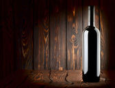Bottle on a wooden background — Stock Photo