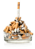 Cigarettes in a glass ashtray — Stock Photo