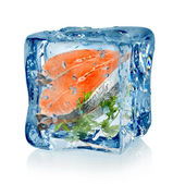 Ice cube and fish with parsley — Foto Stock