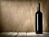 Black bottle of wine — Stock Photo