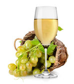 White wine and grapes in a basket — Stock Photo