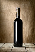 Black bottle of red wine — Stock Photo