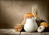 Milk and bread on canvas — Stock Photo