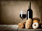 Red wine and assortment of bread — Stock Photo