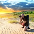 Man in the desert - Stock Photo