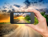 Phone and evening landscape — Stock Photo