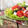 Vegetable salad on a wooden table — Stock Photo