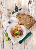 Bacon and bread on a wooden table — Stock Photo
