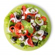 Salad on a green plate — Stock Photo