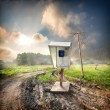 Old payphone in the field — Stock Photo #30413429