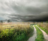 Storm clouds and road — Stock Photo