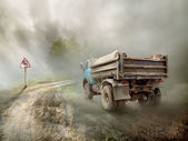 Dirty truck on a country road — Stock Photo
