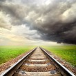 Railway and storm clouds — Stock Photo