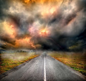 Storm clouds and lightning over highway — Stock Photo