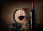 Wine with barrel and hay — Stock Photo