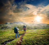 Backpackers in mountains — Stock Photo