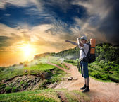 Tourist on the road in mountains — Stock Photo