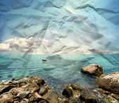Stony beach on paper texture — Stock Photo