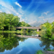 Bridge over silent river — Stock Photo #41049793
