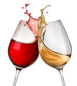 Splashes of wine in two wineglasses — Stock Photo